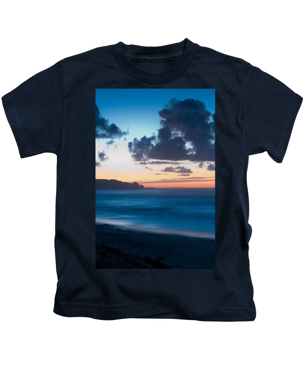 Beach Kids T-Shirt featuring the photograph A Beach During Sunset With Glowing Sky by U Schade