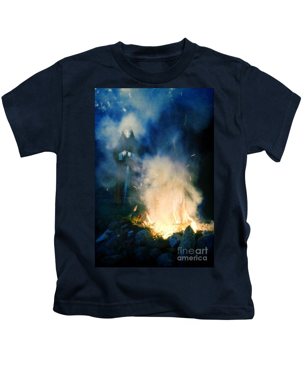 Fire Kids T-Shirt featuring the photograph Hooded Figure In A Mask By A Fire by Jill Battaglia
