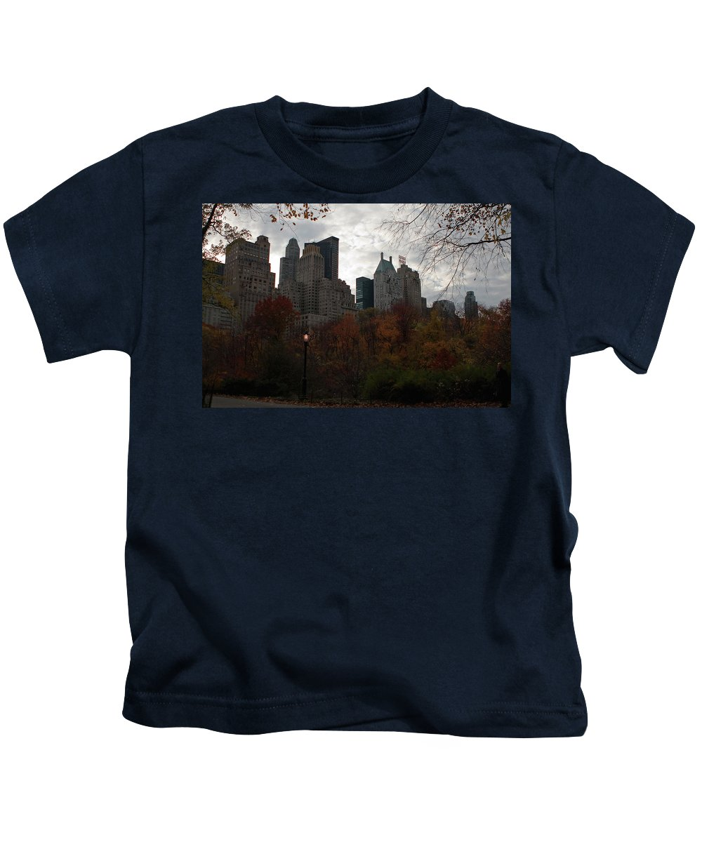 New York City Kids T-Shirt featuring the photograph One Light On In Central Park by Lorraine Devon Wilke