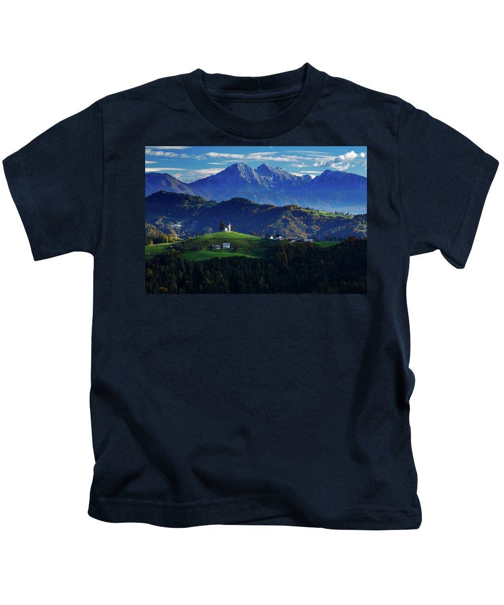 Sveti Kids T-Shirt featuring the photograph Church Of Saint Thomas In The Skofja Loka Hills by Ian Middleton
