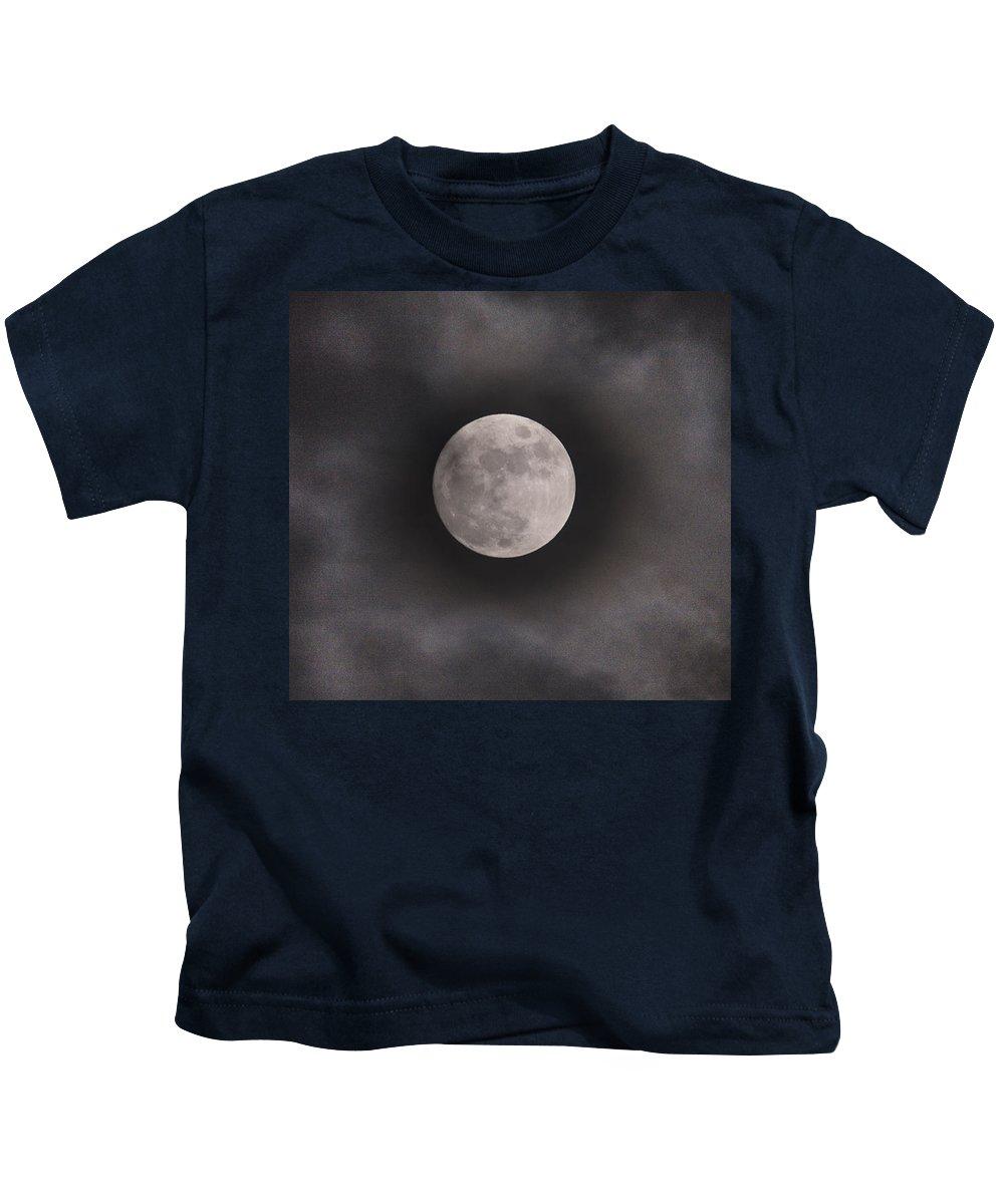 Christmas Moon Kids T-Shirt featuring the photograph Christmas Moon by Domenico Ditanna