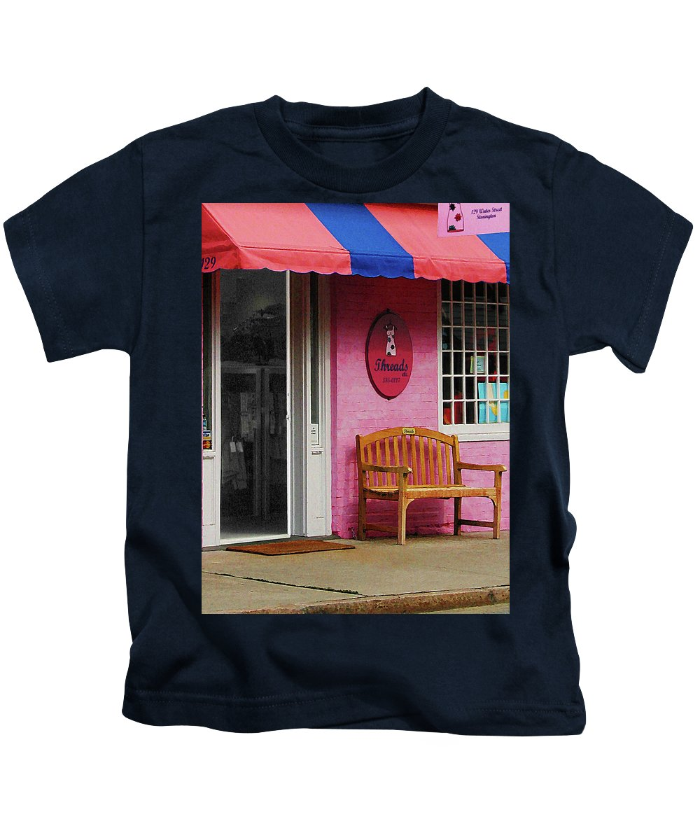 Awning Kids T-Shirt featuring the photograph Dress Shop With Orange And Blue Awning by Susan Savad