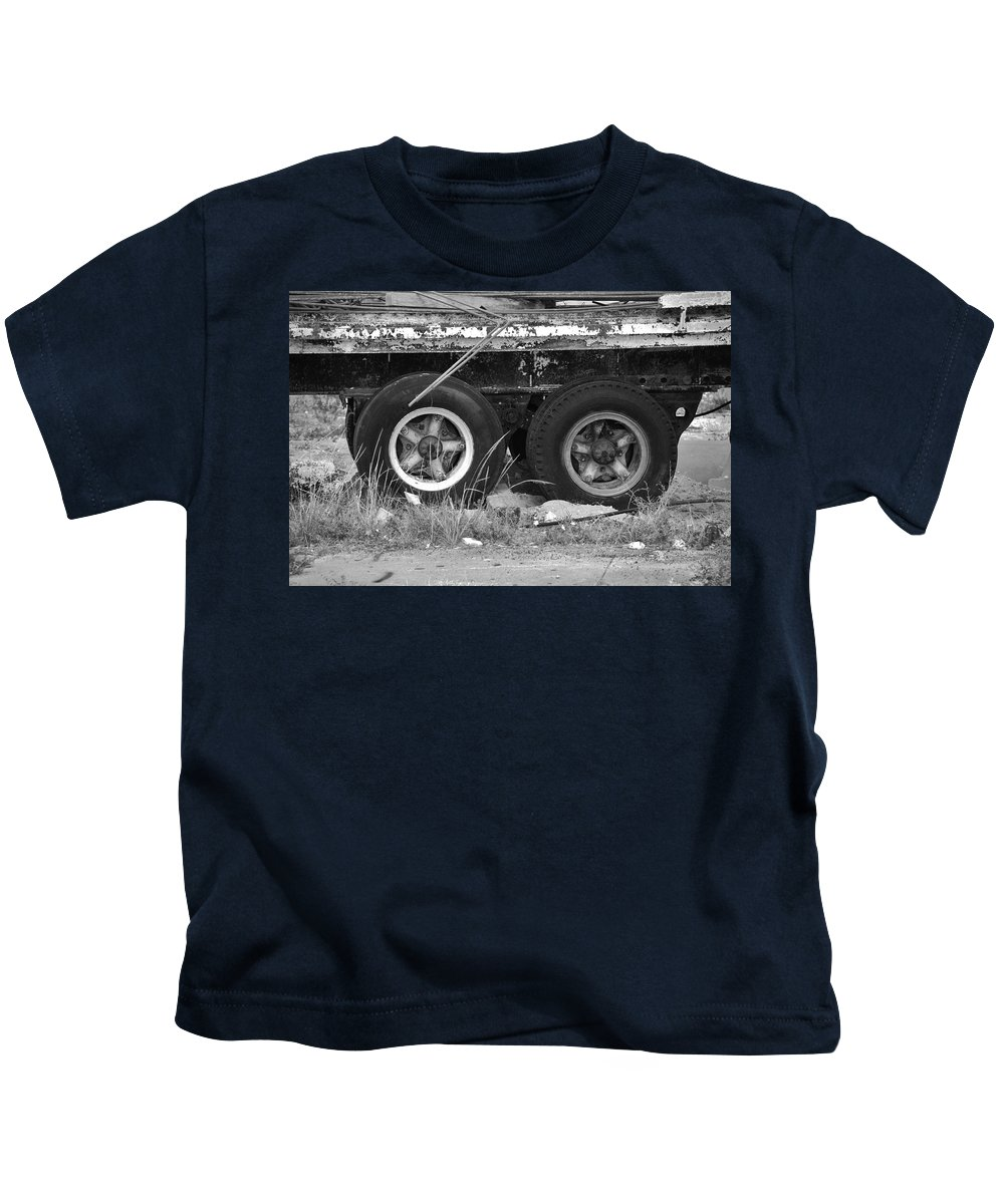 Black And White Kids T-Shirt featuring the photograph Tires by Rob Hans