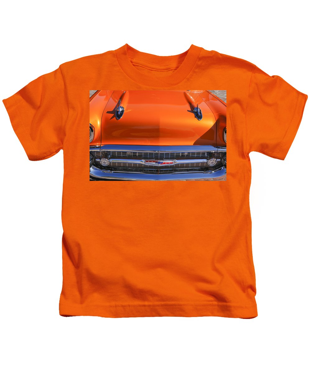 1957 Chevrolet Bel Air Hood Ornament Kids T-Shirt featuring the photograph 1957 Chevrolet Belair Hood Ornament - Grille Emblem -055c by Jill Reger