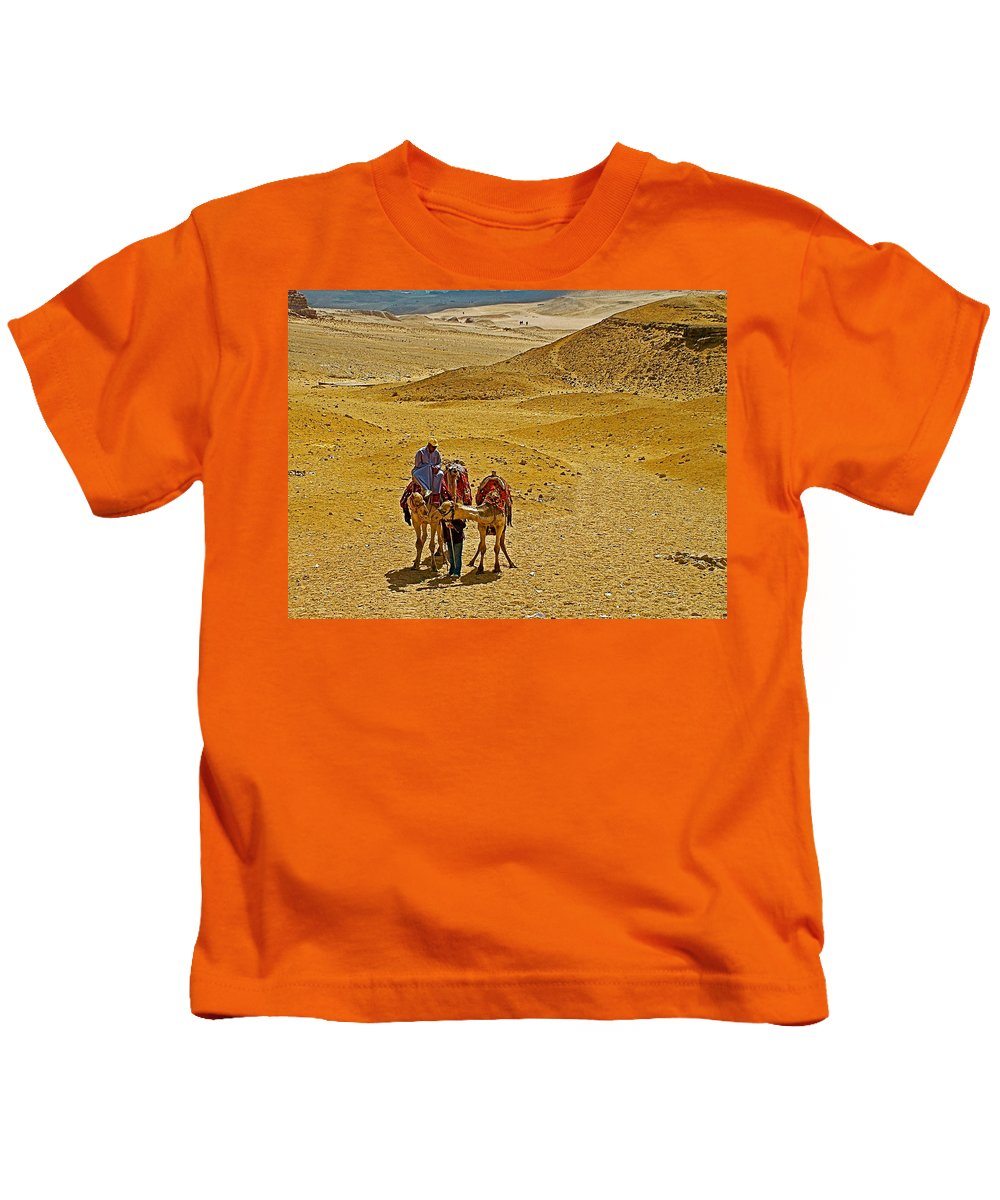 Camels Nuzzling On The Giza Plateau Kids T-Shirt featuring the photograph Camels Nuzzling On The Giza Plateau-egypt by Ruth Hager