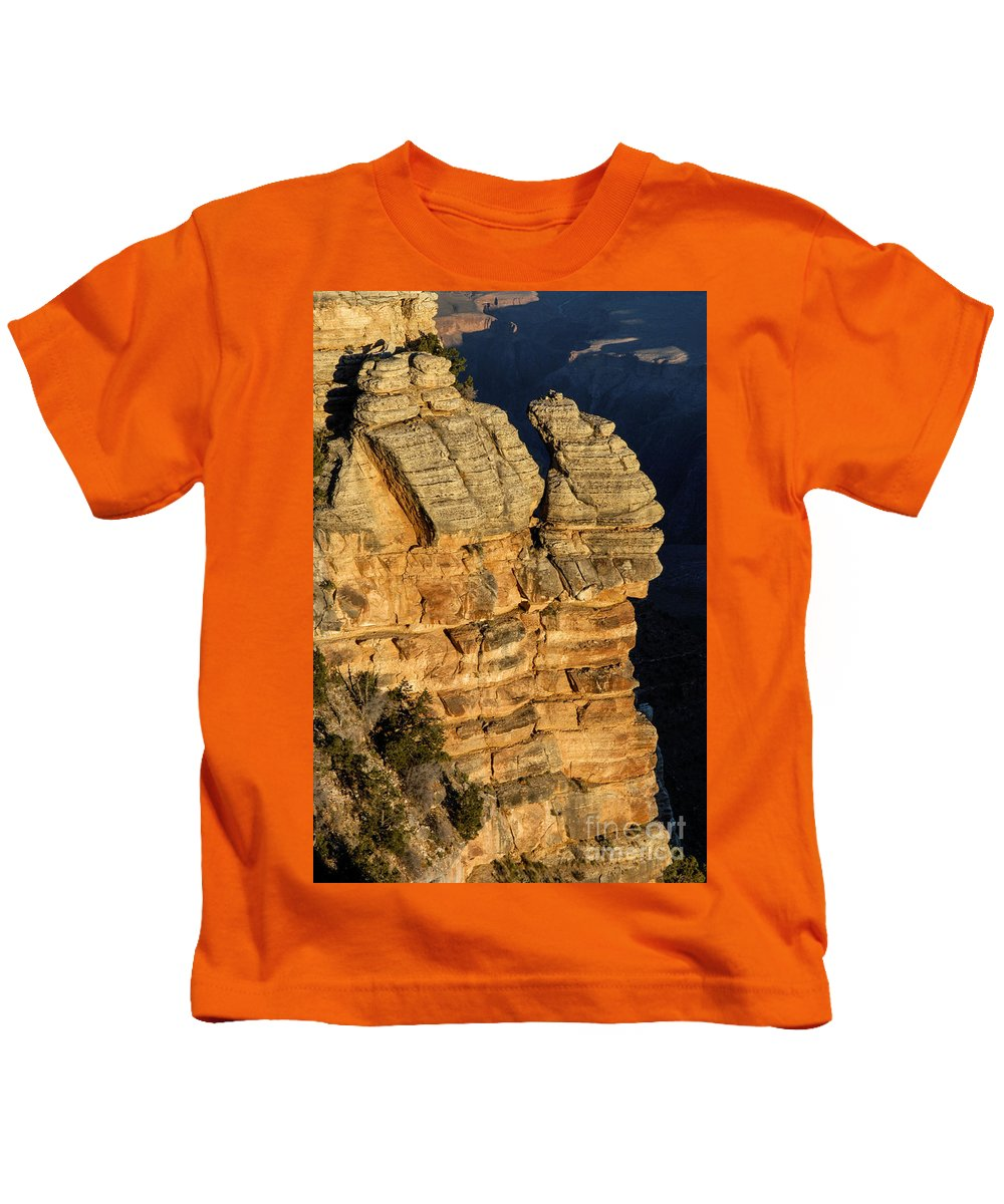 Grand Canyon National Park Arizona Parks Mather Point South Rim Canyons Rock Formations Rock Formation Sunrise Sunrises Landscape Landscapes Landmark Landmarks Kids T-Shirt featuring the photograph Day Break At Mather Point by Bob Phillips