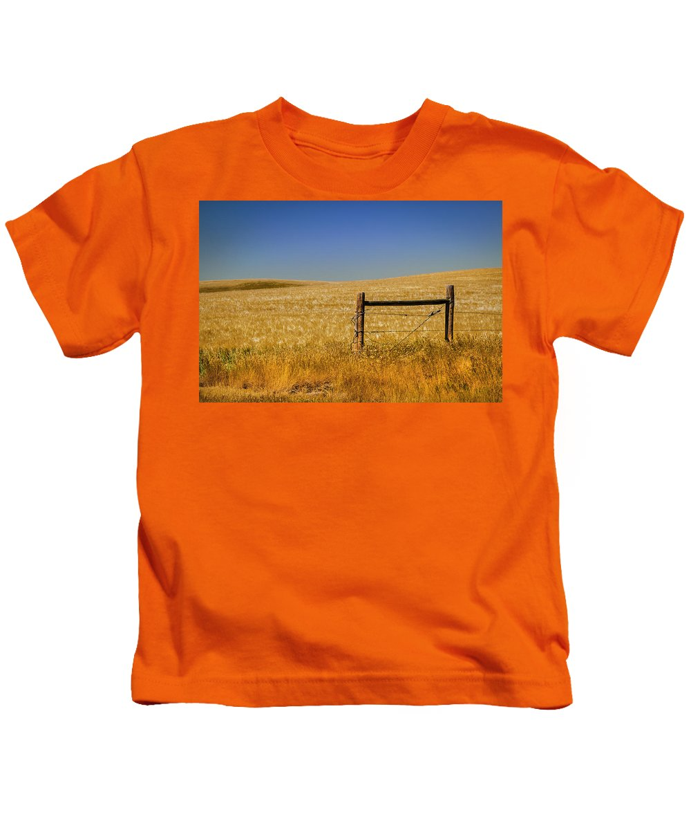Western Kids T-Shirt featuring the photograph Fence Post Near Choteau Montana by Rich Franco