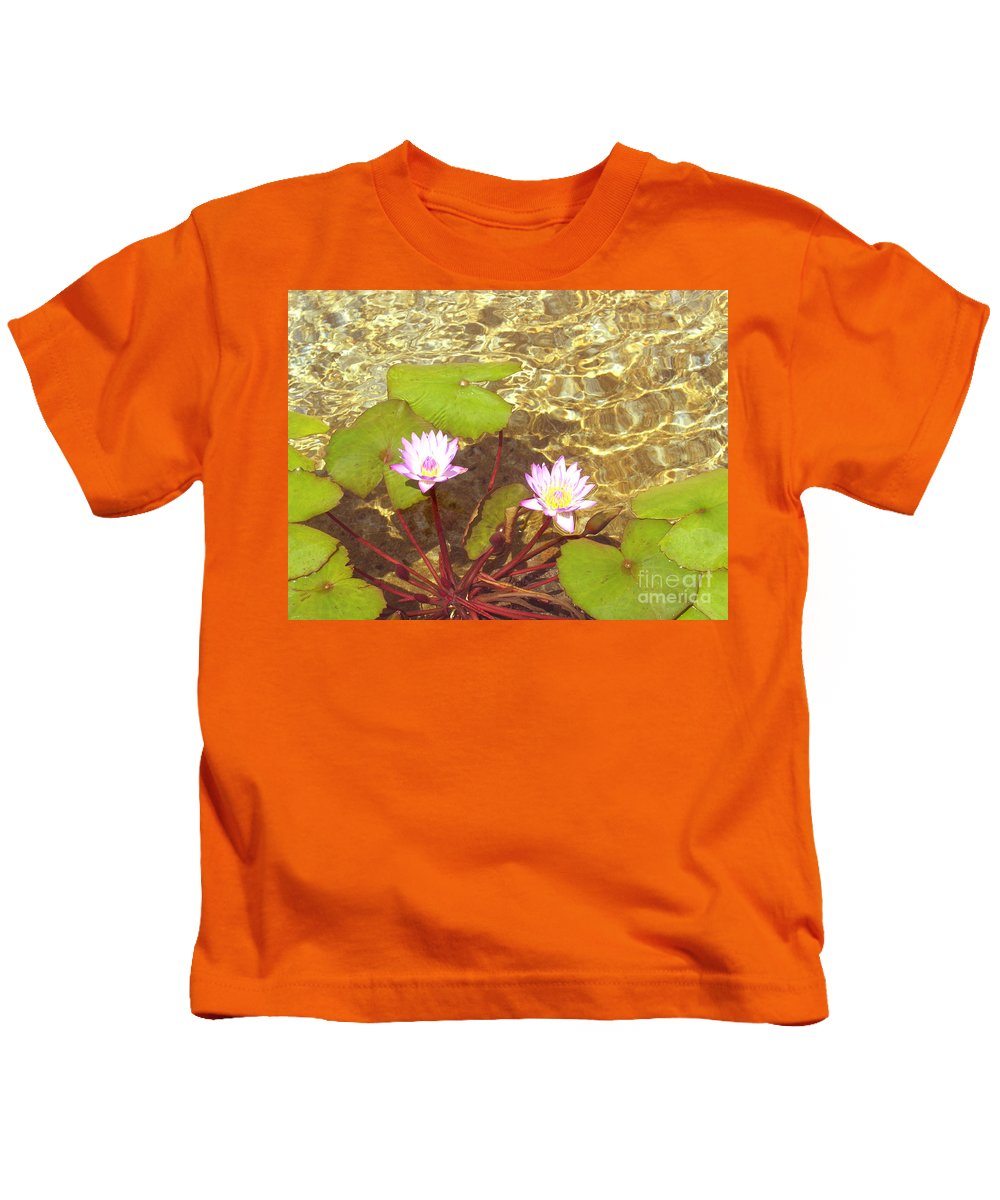 Lotus In Pond Kids T-Shirt featuring the photograph Lotus by Mini Arora