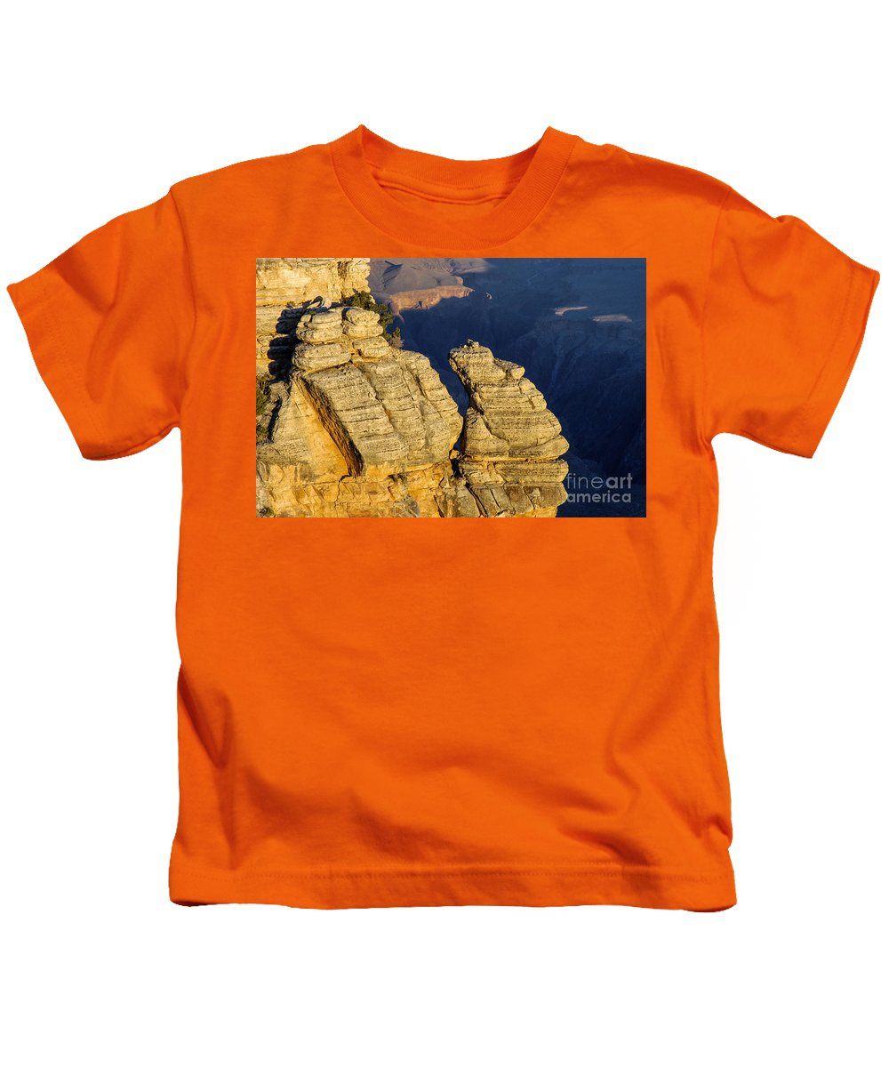 Grand Canyon National Park Arizona Parks Mather Point South Rim Canyons Rock Formations Rock Formation Sunrise Sunrises Landscape Landscapes Landmark Landmarks Kids T-Shirt featuring the photograph Mather Point by Bob Phillips