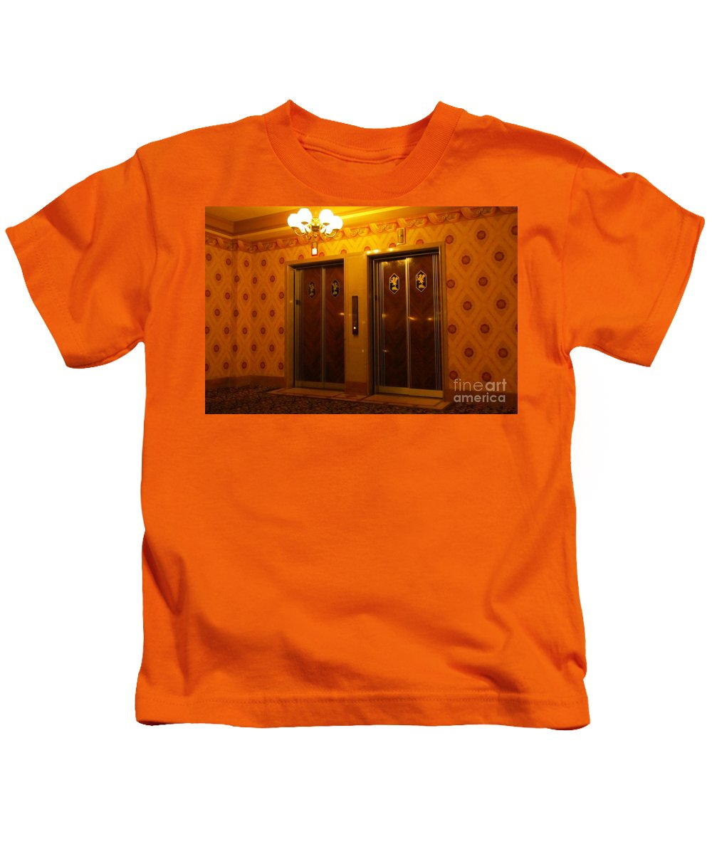 Old Elevators Kids T-Shirt featuring the photograph Old Westinghouse Elevators At The Brown Palace Hotel In Denver by John Malone