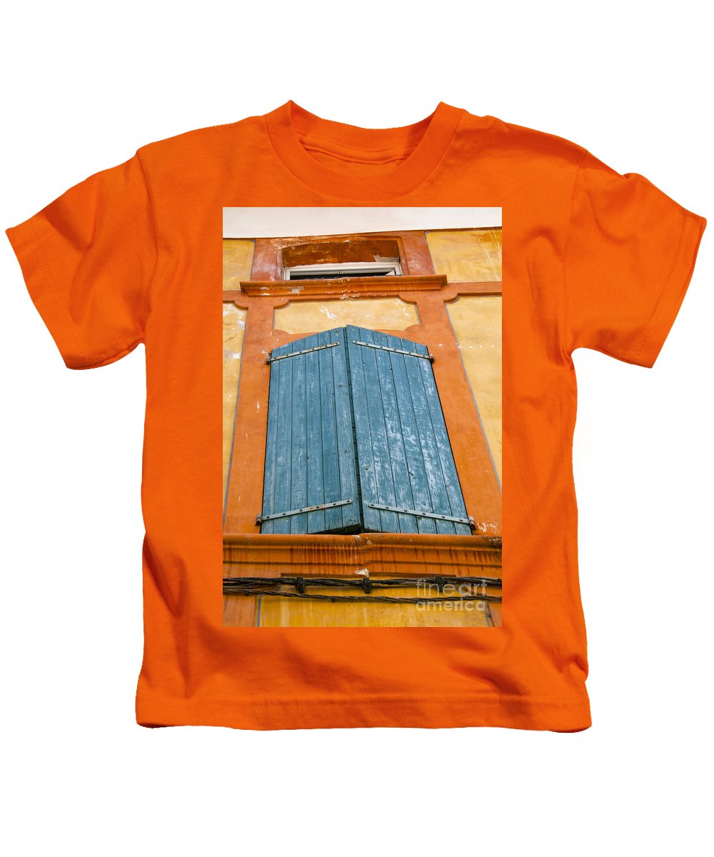 Apt France Window Windows Shutter Shutters City Cities Cityscape Cityscapes Provence Kids T-Shirt featuring the photograph Orange And Blue by Bob Phillips