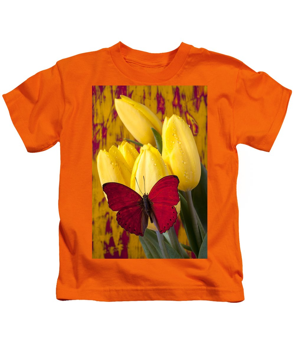 Red Kids T-Shirt featuring the photograph Red Butterfly Resting On Tulips by Garry Gay