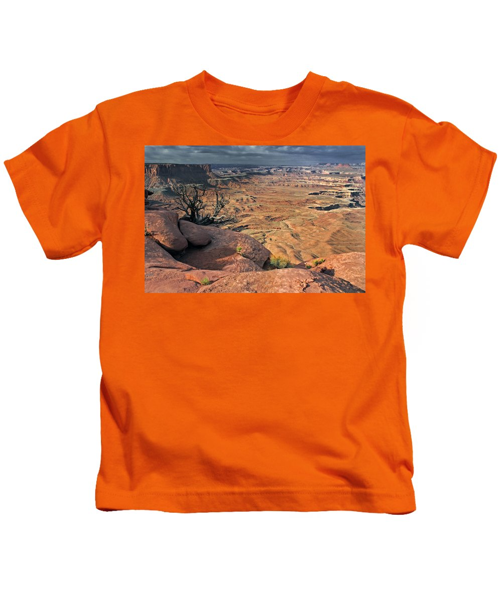 Canyonlands National Park Kids T-Shirt featuring the photograph Stormy Skies In Canyonlands by Dave Mills