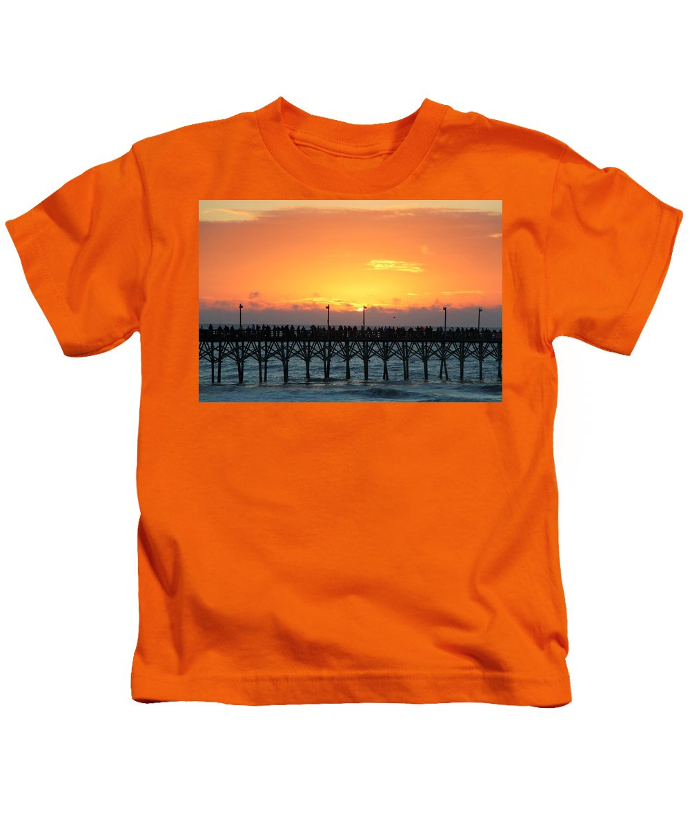 Sun Up Kids T-Shirt featuring the photograph Sun In Clouds Over Pier by Rand Wall