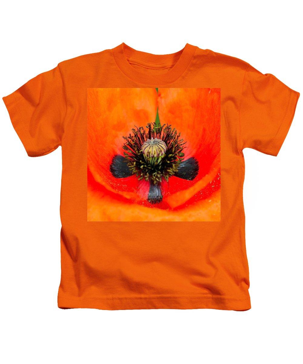 Poppy Kids T-Shirt featuring the photograph Poppy Heart by Karon Melillo DeVega