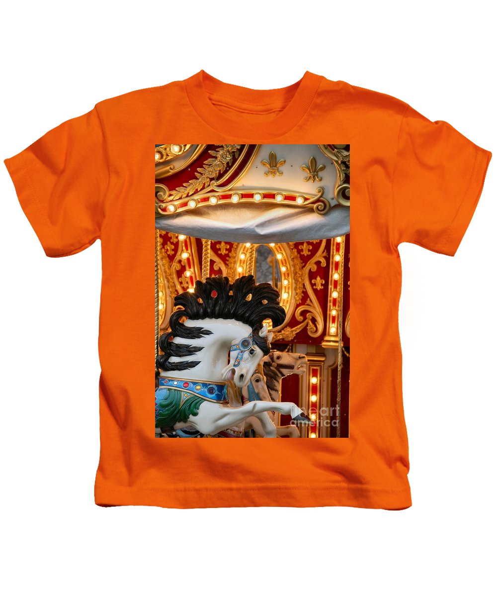 Carousel Kids T-Shirt featuring the photograph Carousel In Motion by Anjanette Douglas