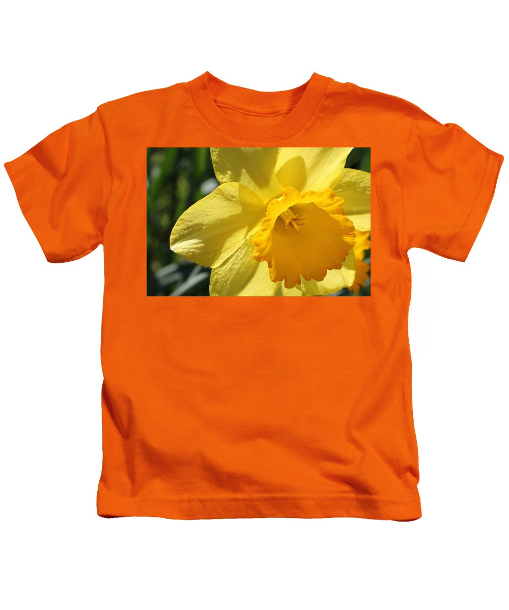 Daffodil Kids T-Shirt featuring the photograph Just For The Frill Of It by Betty Northcutt