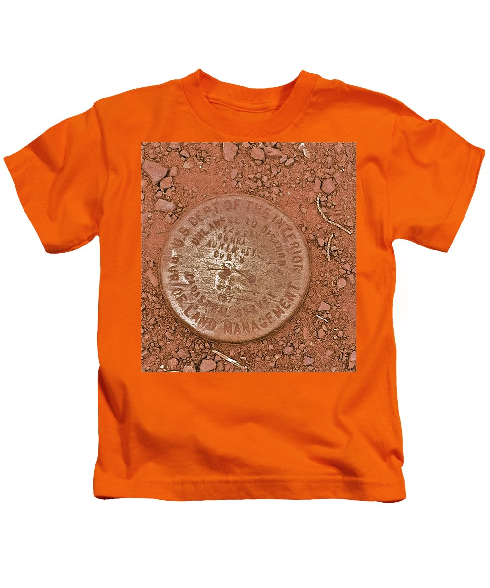 Us Dept. Of The Interior Kids T-Shirt featuring the photograph Land Survey Marker by Bill Owen