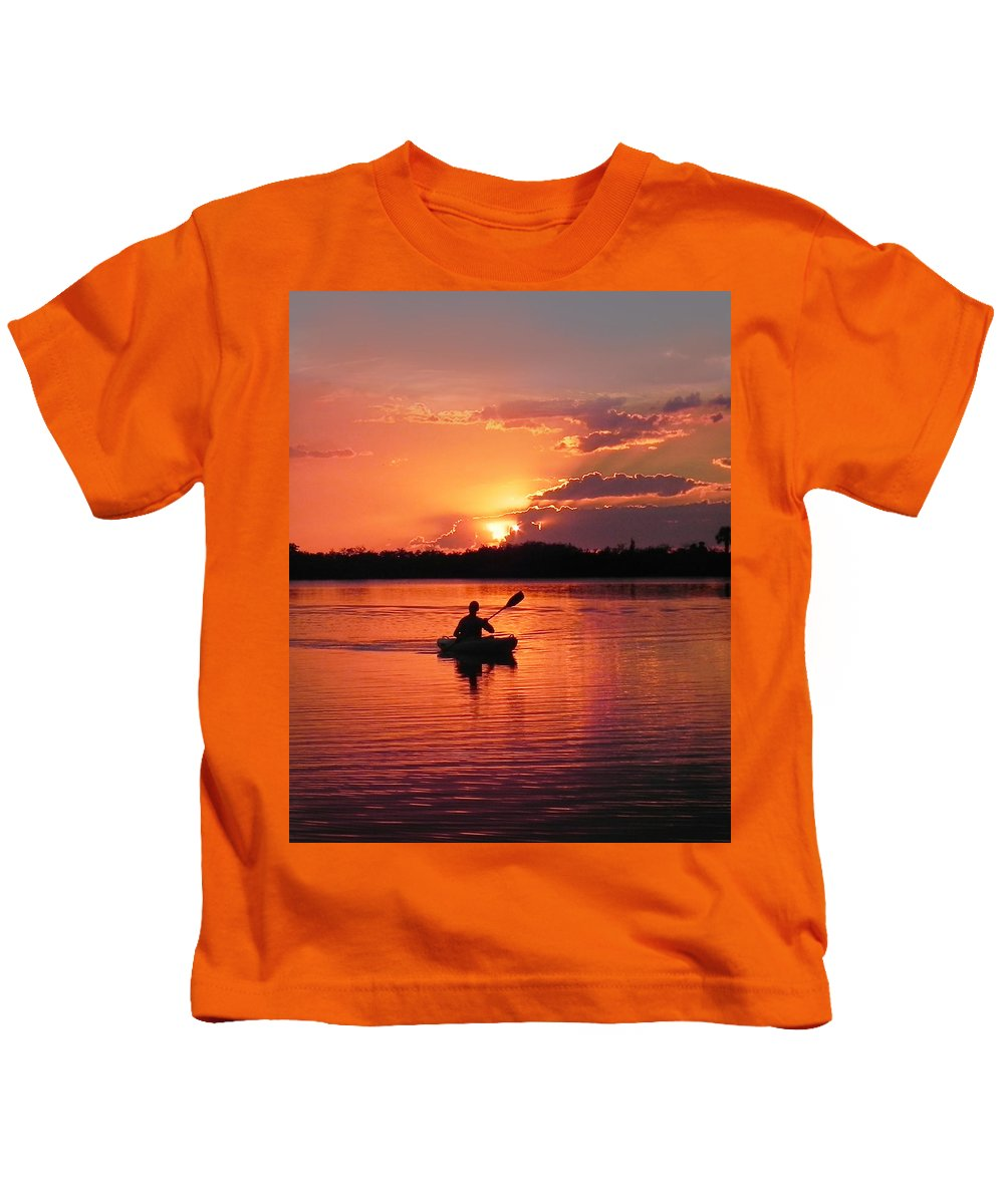 Canoe; Kayak; Sunset; Twilight; Evening; Lake; Lagoon; River; Water; Reflection; Reflecting; Wake Kids T-Shirt featuring the photograph Paddle To Home by Francesa Miller