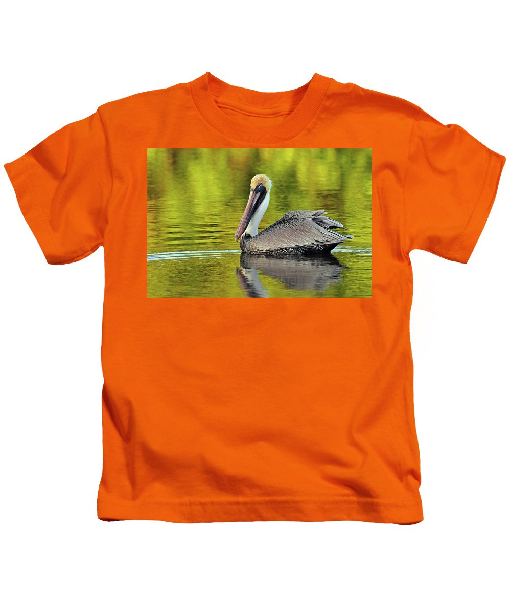 Pelican Kids T-Shirt featuring the photograph Pelican On A Golden Pond by Dave Mills