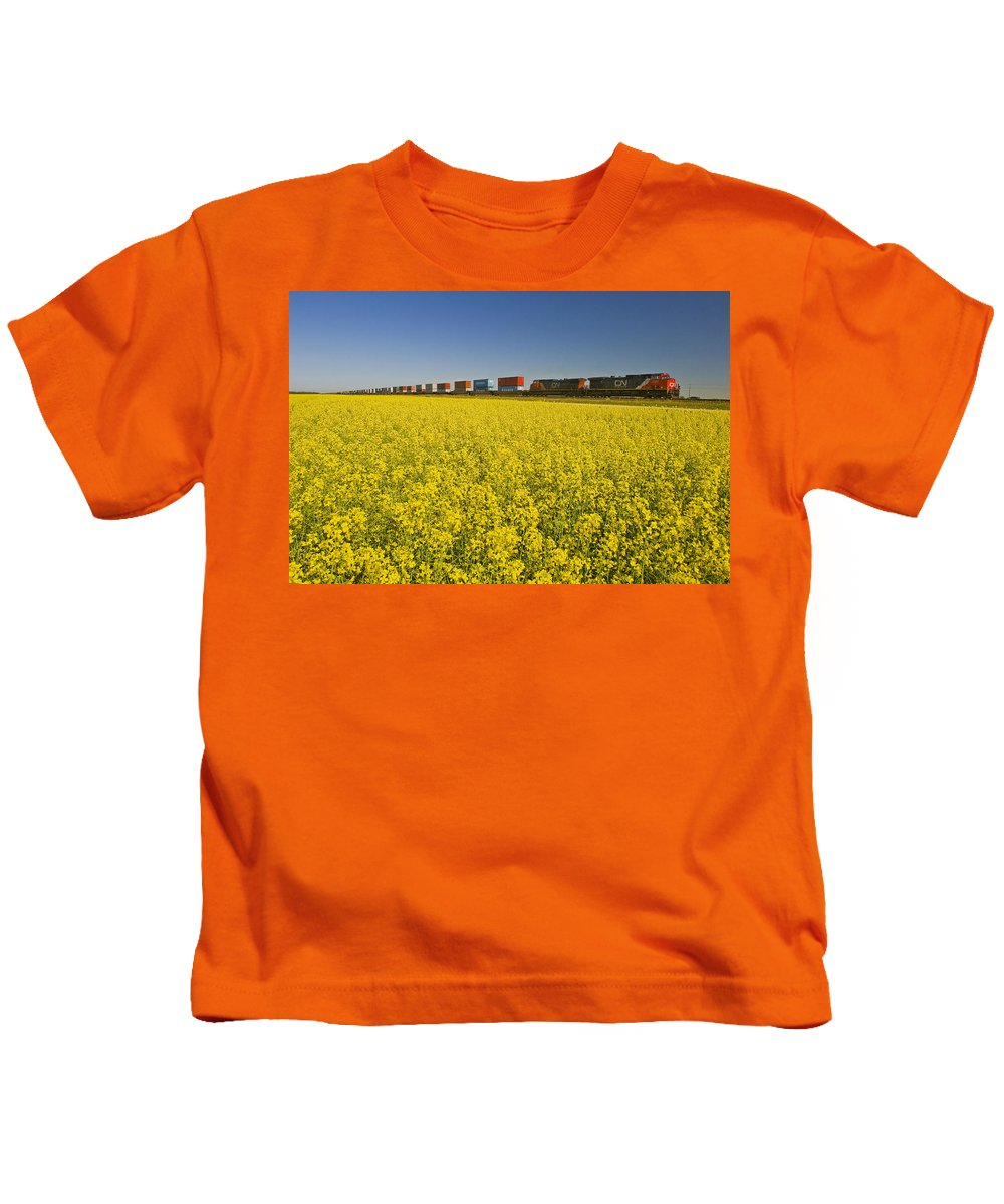 Blooming Kids T-Shirt featuring the photograph Rail Cars Carrying Containers Passe by Dave Reede
