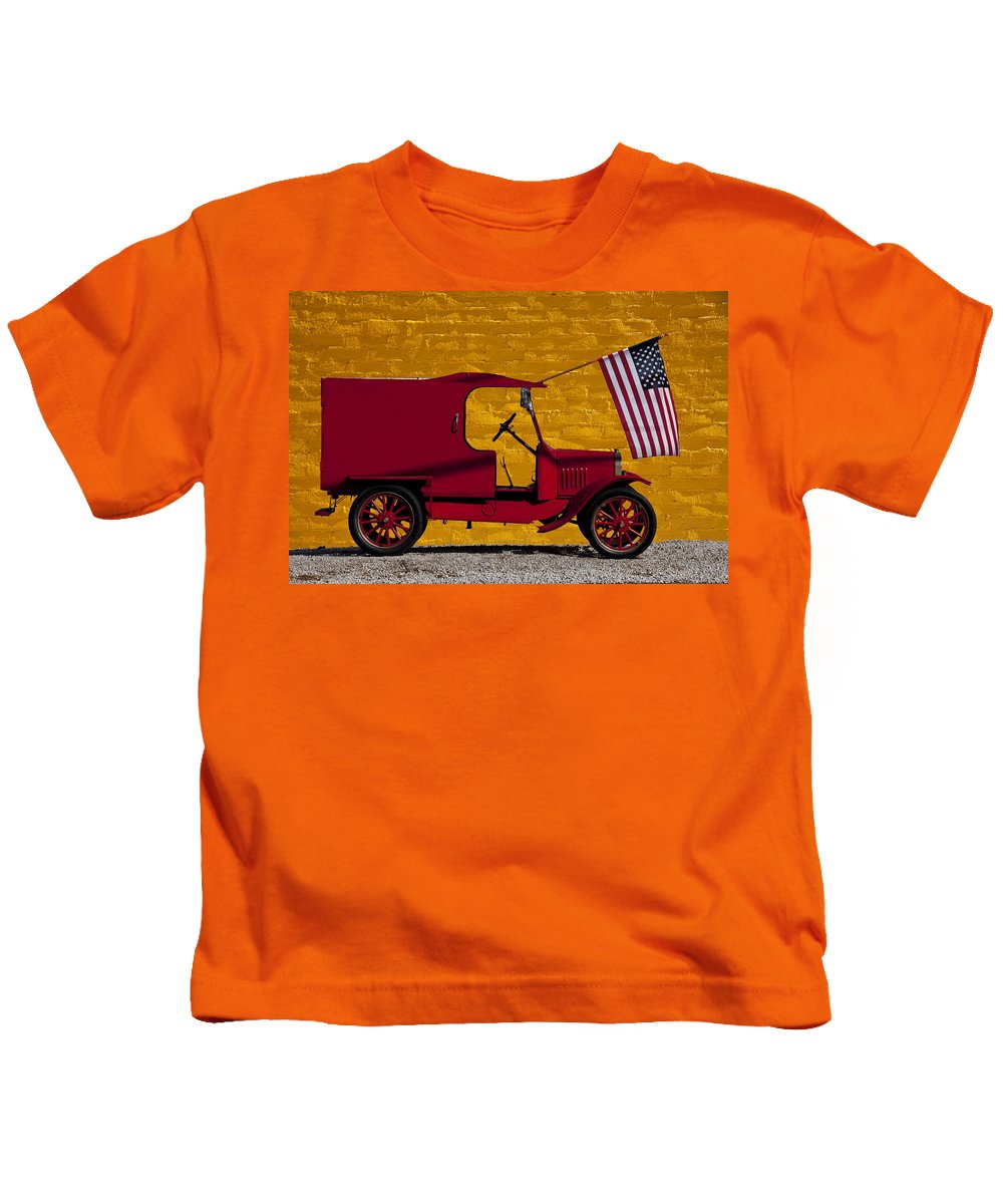 Red Kids T-Shirt featuring the photograph Red Truck Against Yellow Wall by Garry Gay