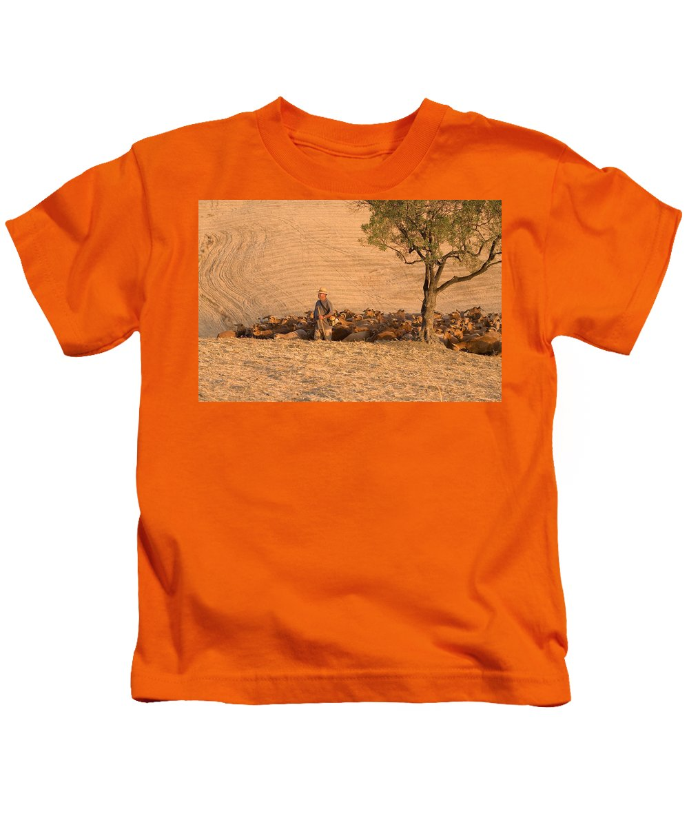 Goat Kids T-Shirt featuring the photograph Goatherd by Mal Bray
