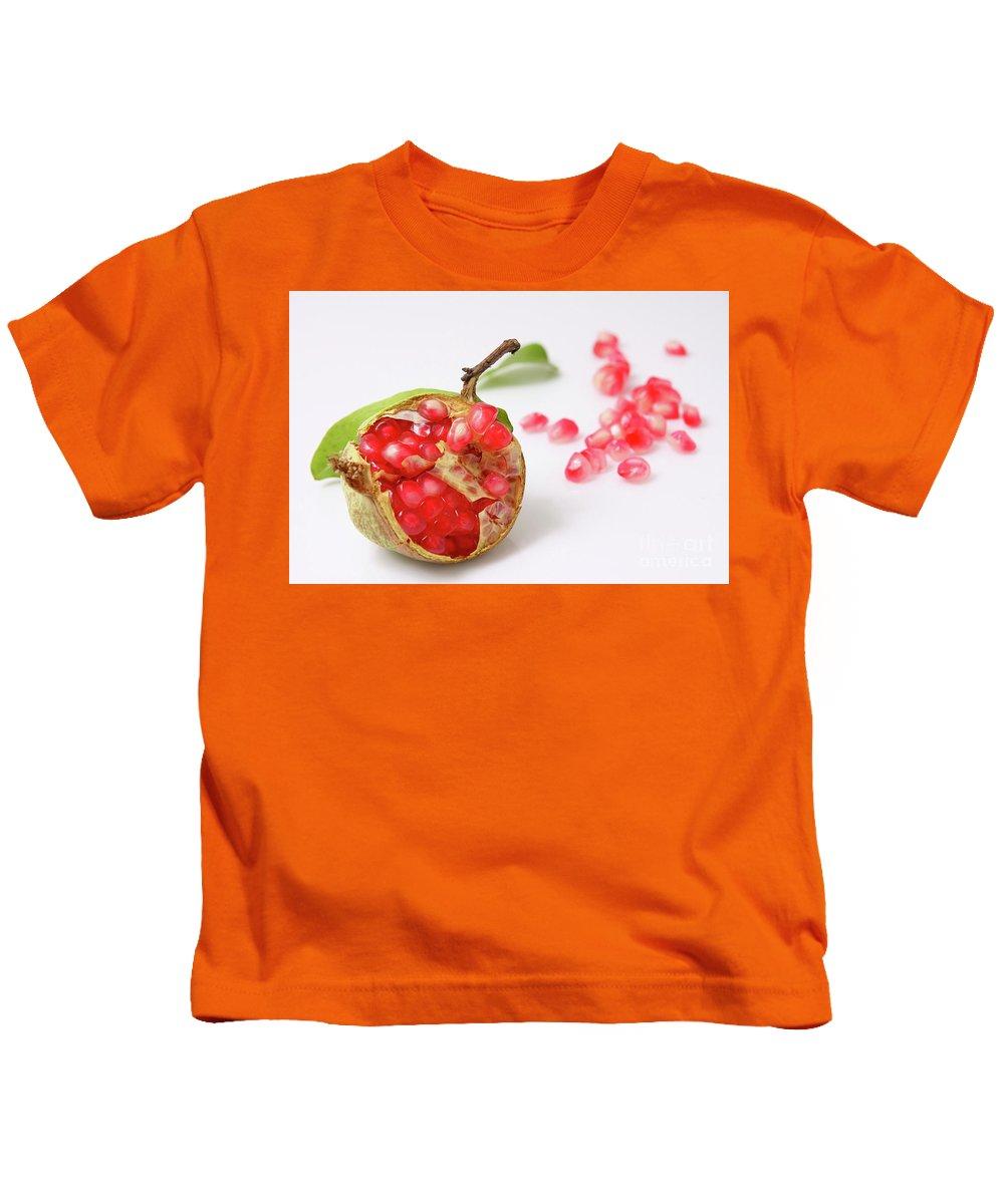 Cut Kids T-Shirt featuring the photograph Pomegranate by Yedidya yos mizrachi
