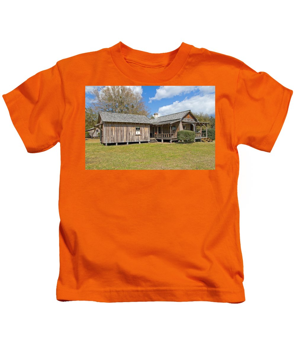 Cabin Kids T-Shirt featuring the photograph 1912 Simmons Farm In Christmas Florida by Allan Hughes