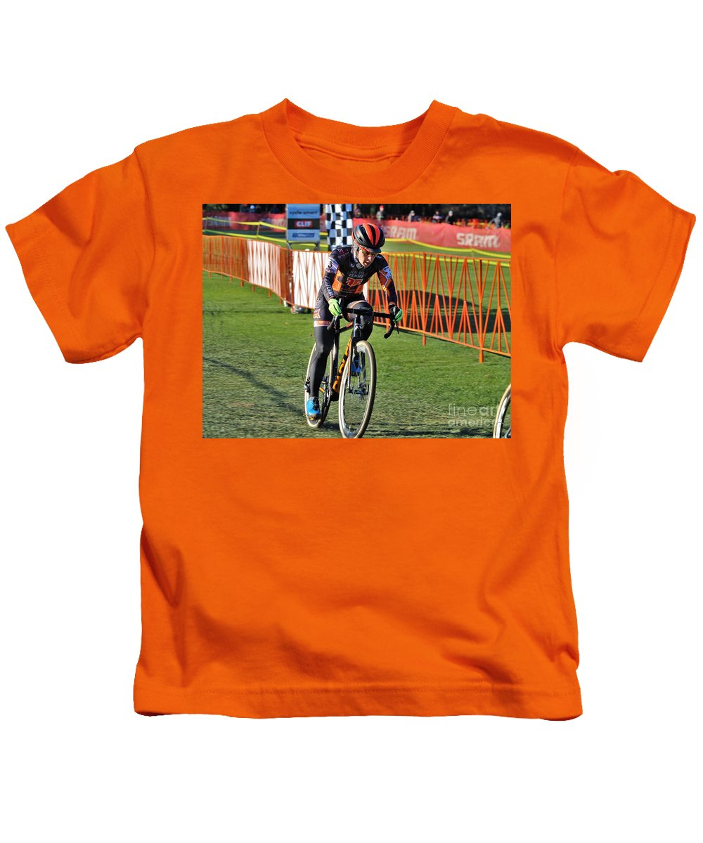 Longsjo Classic Kids T-Shirt featuring the photograph Fearless Femme Racing by Donn Ingemie