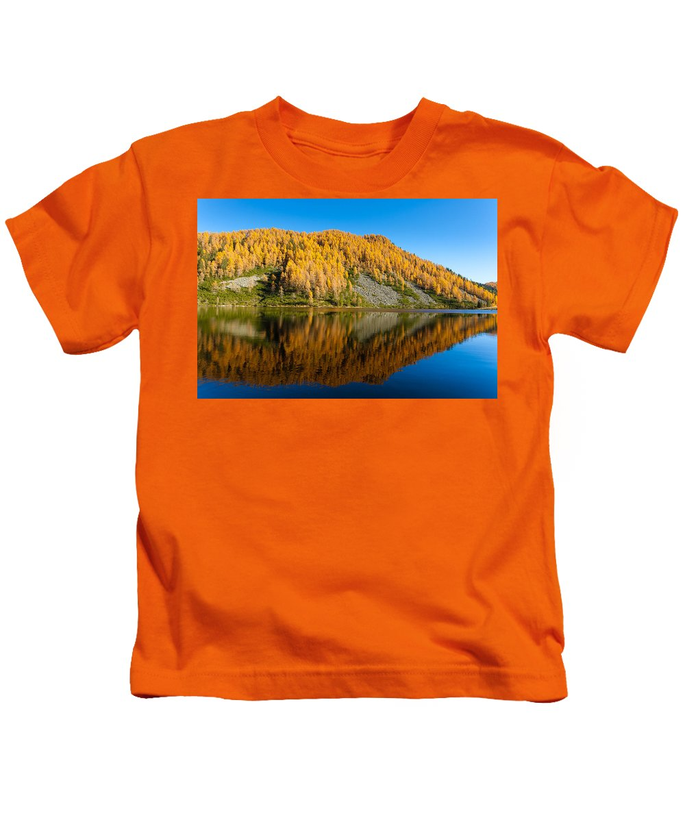 Alps Kids T-Shirt featuring the photograph Reflections On Water, Autumn Panorama From Mountain Lake by Davide Guidolin