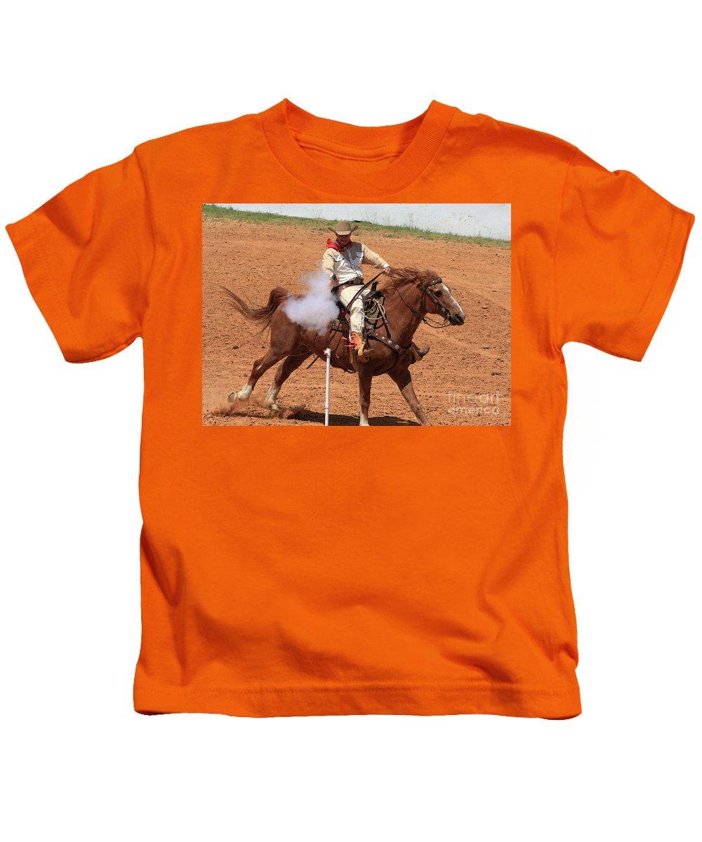 Western Art Kids T-Shirt featuring the photograph Aim..fire..pop by Kim Henderson