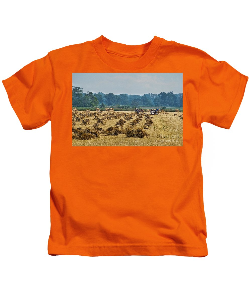 Amish Kids T-Shirt featuring the photograph Amish Making Grain Shocks by David Arment