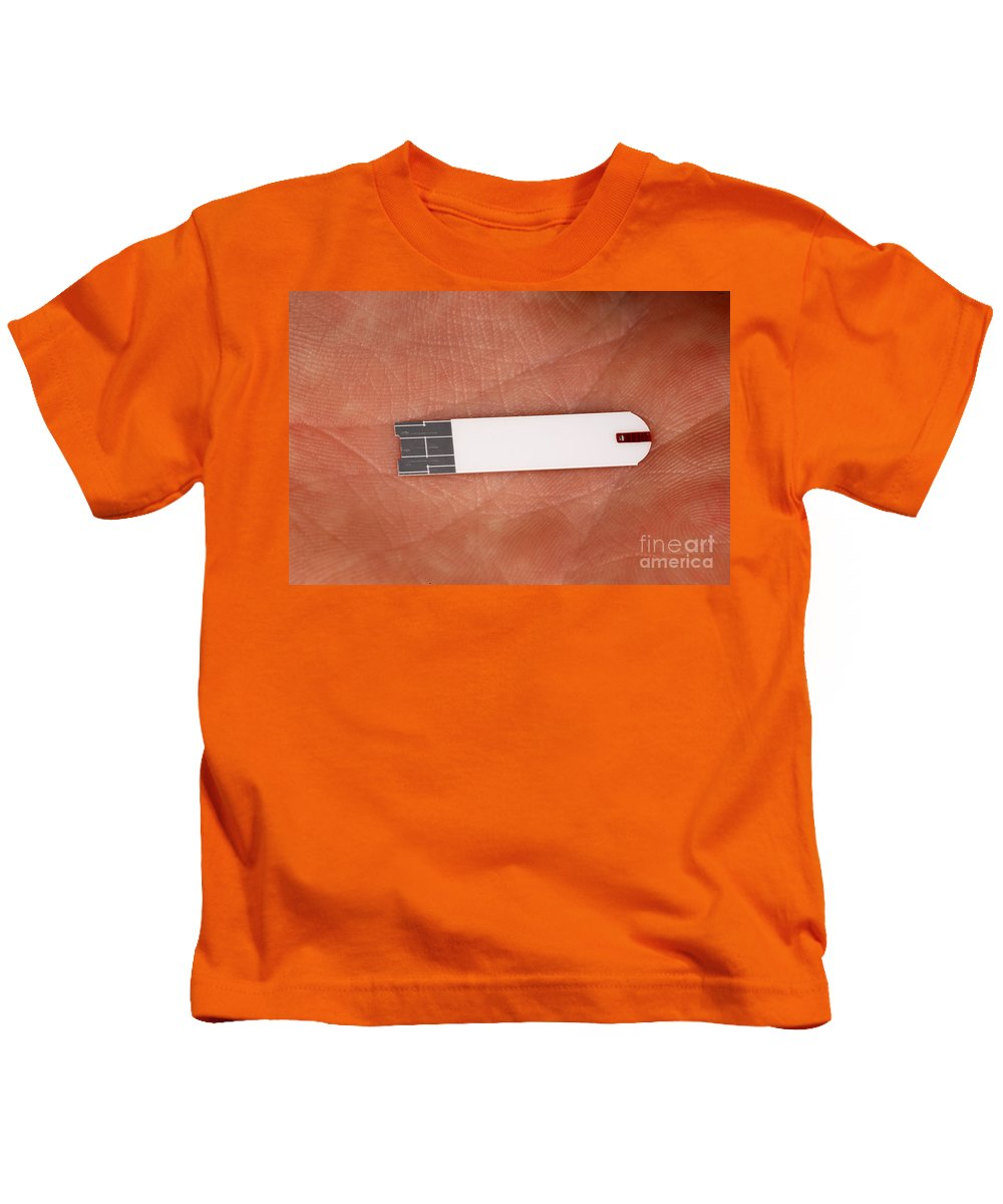People Kids T-Shirt featuring the photograph Blood Glucose Test Strip by Ted Kinsman