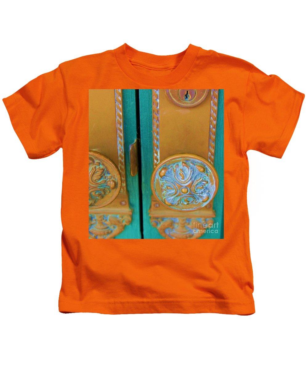 Door Kids T-Shirt featuring the photograph Brass Is Green by Debbi Granruth