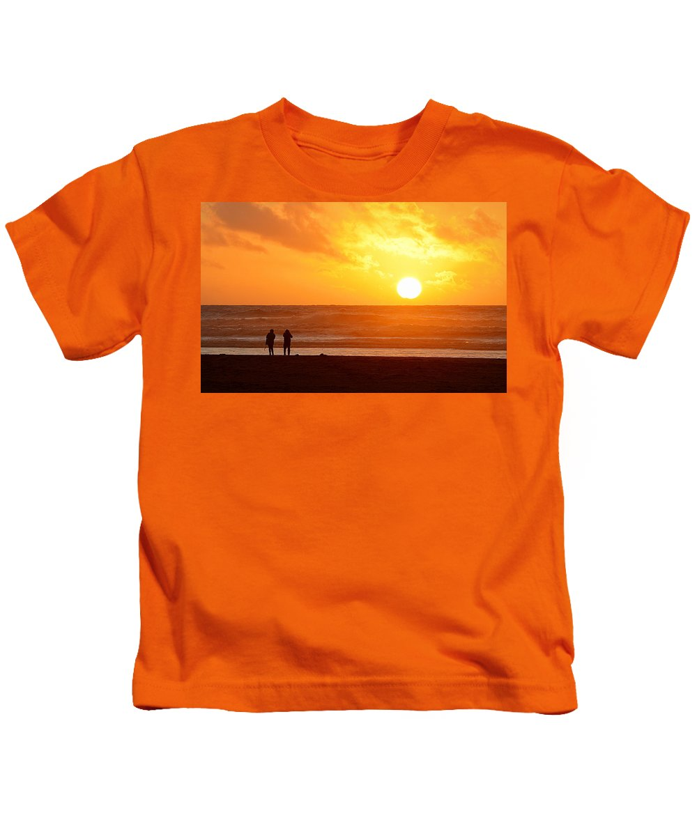 Scenic Kids T-Shirt featuring the photograph Catching A Setting Sun by AJ Schibig