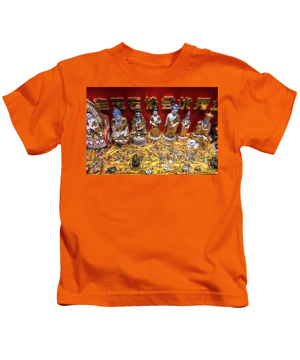 Amulets Kids T-Shirt featuring the photograph Chinese Religious Trinkets And Statues On Display In Xiamen Chin by Jacek Malipan
