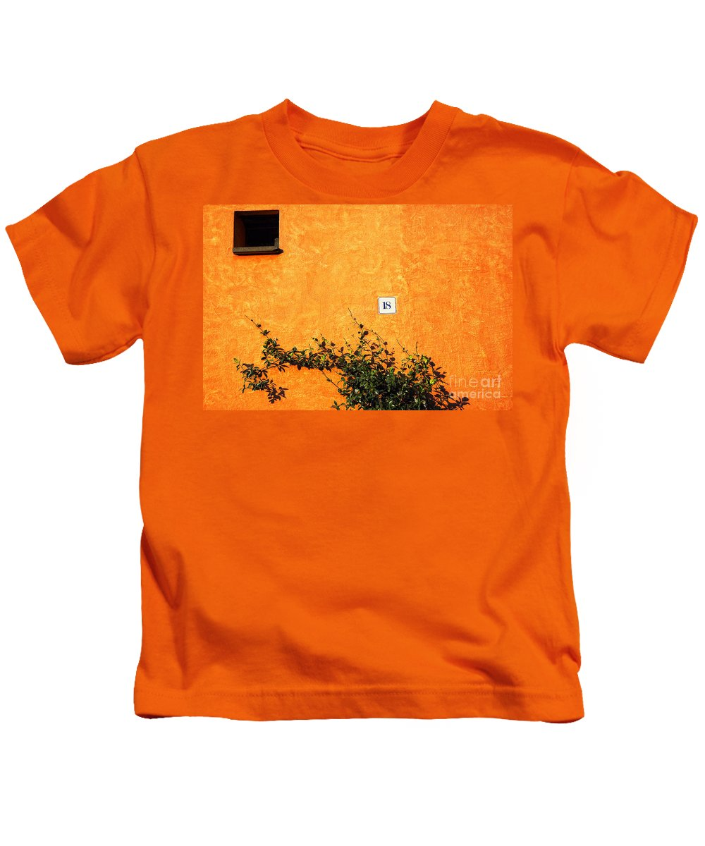 Numbers Kids T-Shirt featuring the photograph Eighteen On Orange Wall by Silvia Ganora