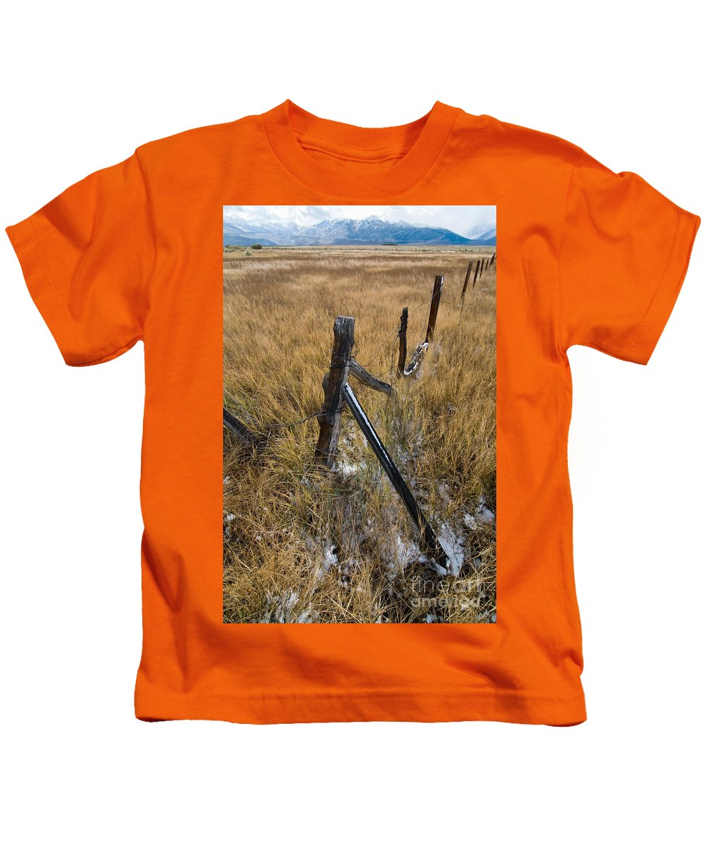 Landscapes Kids T-Shirt featuring the photograph Fence To Nowhere by Norman Andrus