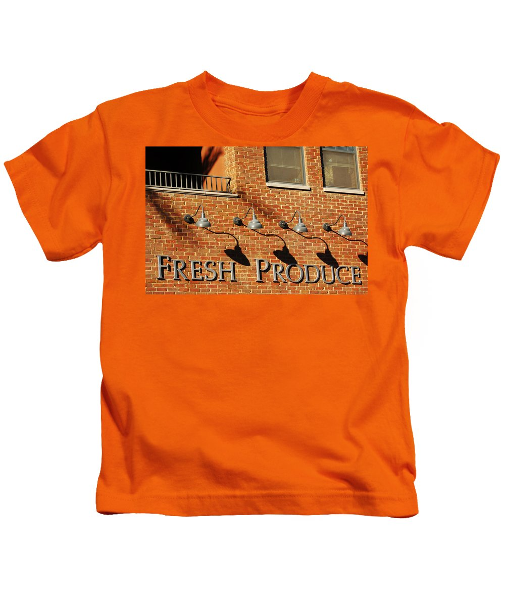 Brick Building Architecture Fresh Produce Lamps Abstract Kids T-Shirt featuring the photograph Fresh Produce Signage by Jill Reger