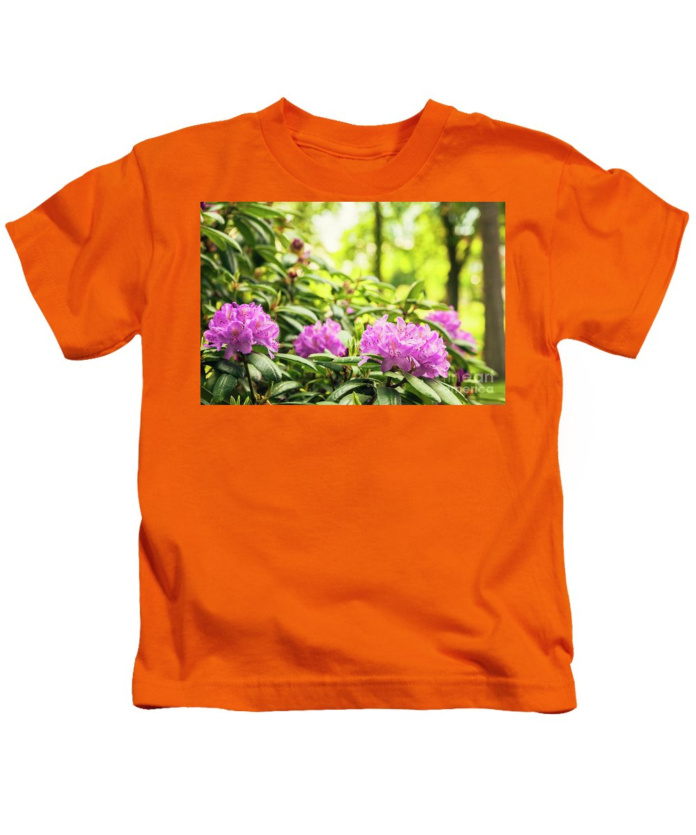 Purple Kids T-Shirt featuring the photograph Garden Rododendron Bush by Sophie McAulay