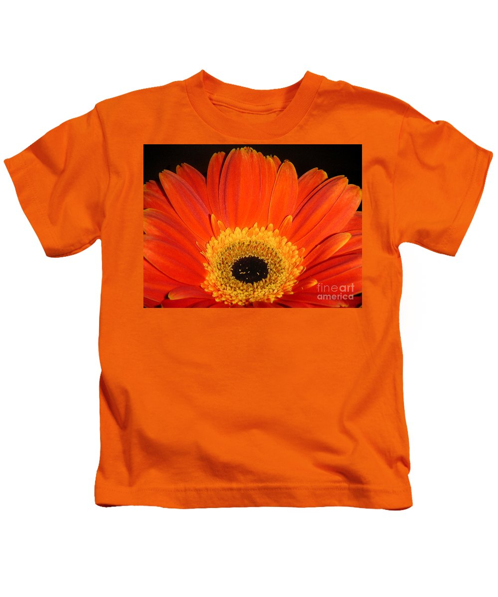 Nature Kids T-Shirt featuring the photograph Gerbera Daisy - Glowing In The Dark by Lucyna A M Green
