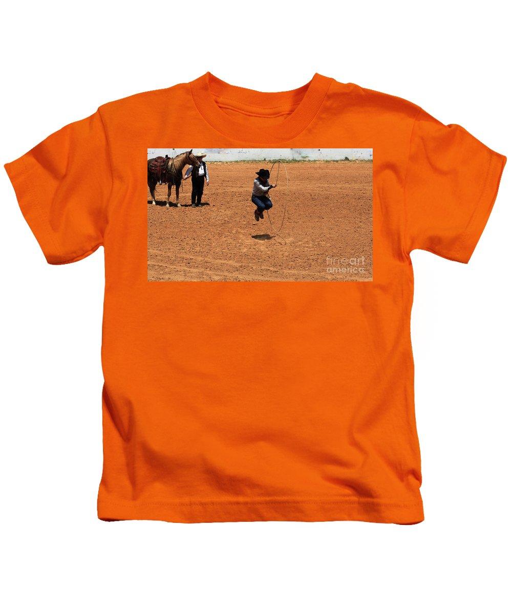 Western Art Kids T-Shirt featuring the photograph High Steppin Cowboy by Kim Henderson