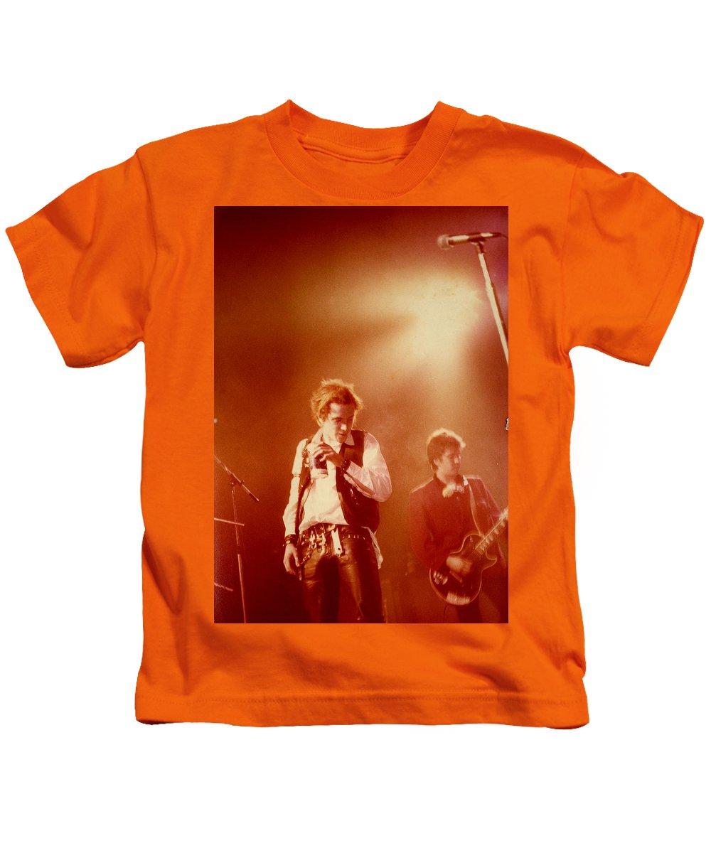 Sex Pistols  Punk Rock  Johnny Lydon  Johnny Rotten Steve Jones Kids T-Shirt featuring the photograph Johnny Rotten and Steve Jones by Dawn Wirth