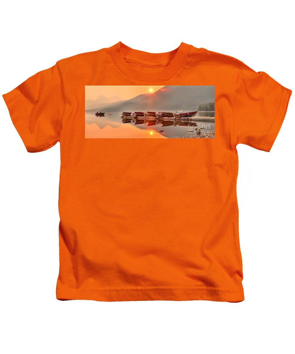 Lake Mcdonald Kids T-Shirt featuring the photograph Lake Mcdonald Fiery Sunset by Adam Jewell