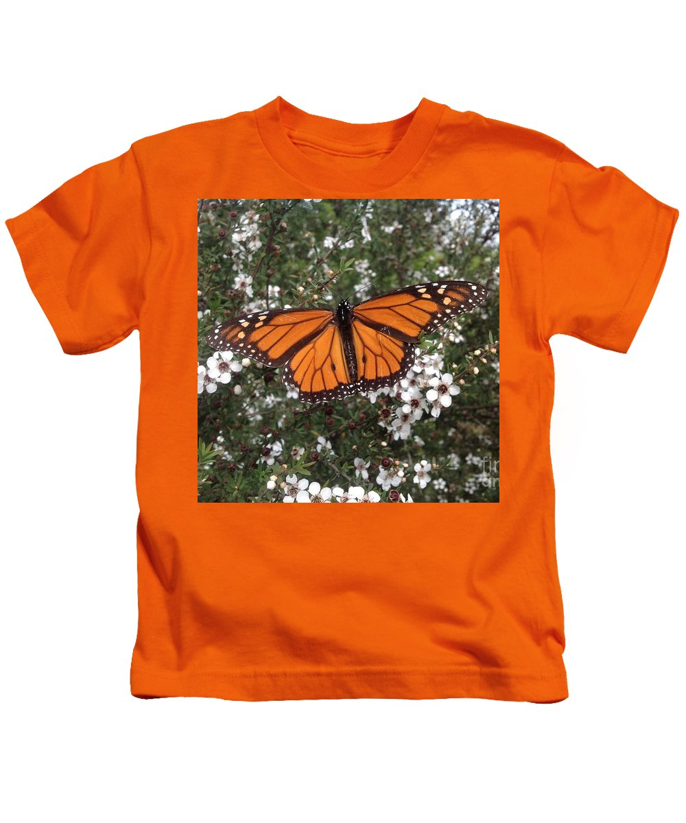 Monarch Butterfly Kids T-Shirt featuring the photograph Monarch Butterfly On New Zealand Teatree Bush by By Divine Light