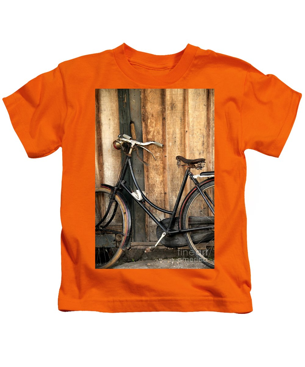 Bi-cycle Kids T-Shirt featuring the photograph Parked by Charuhas Images