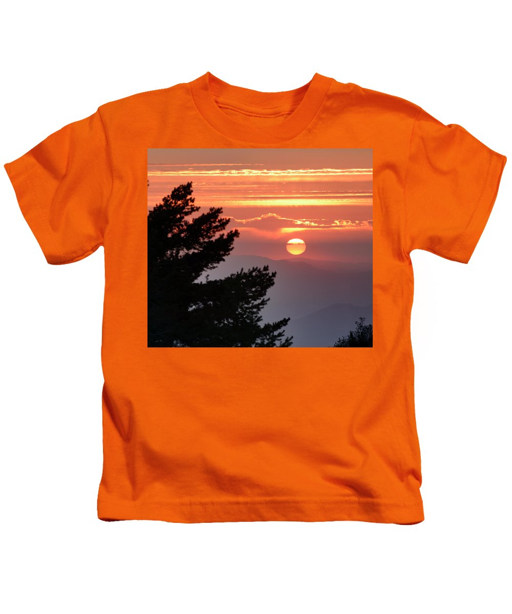 Sunset Kids T-Shirt featuring the photograph Sun Through The Clouds And Trees Sunset At The Mountains by Guido Montanes Castillo