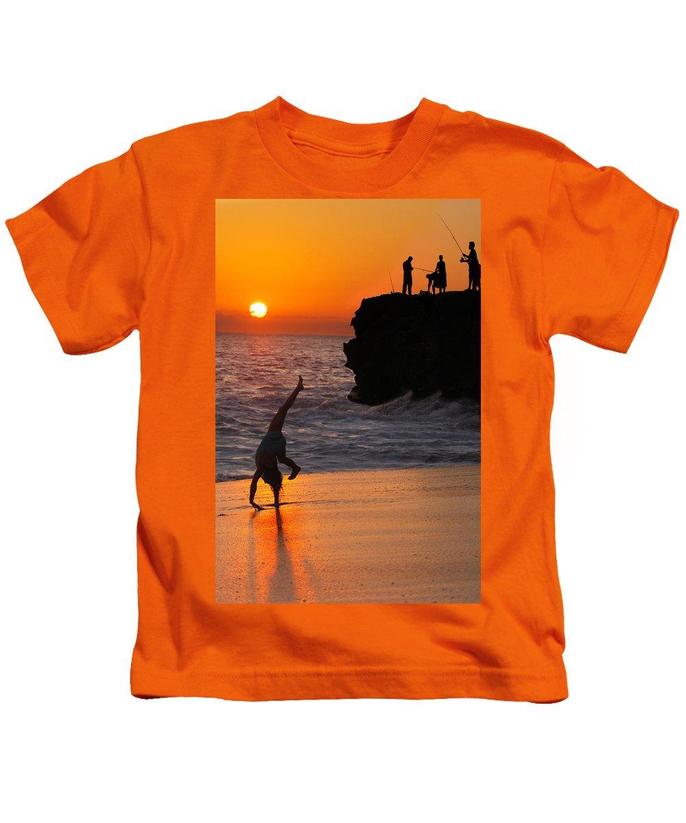 Beach Kids T-Shirt featuring the photograph Sunset Cartwheel by Jill Reger