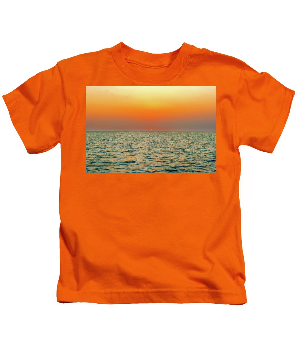 Sunset Kids T-Shirt featuring the photograph Sunset Over The Ocean In Galapagos by Marek Poplawski